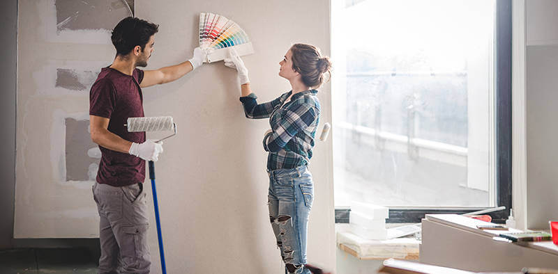 couple choses paint colors for renovatiing their home