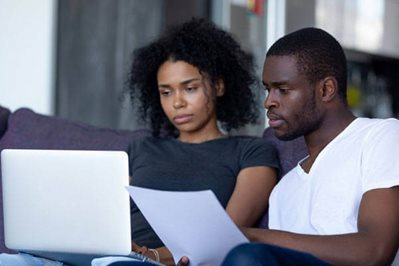 Couple looking at a laptop